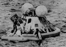 apollo-13-astronauts-haise-and-swigert-waiting-in-raft-as-lovell-comes-aboard-during-recovery-operation